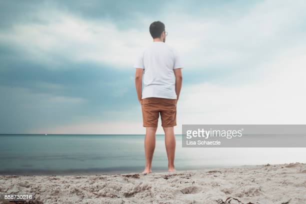 male tourist looking at baltic sea