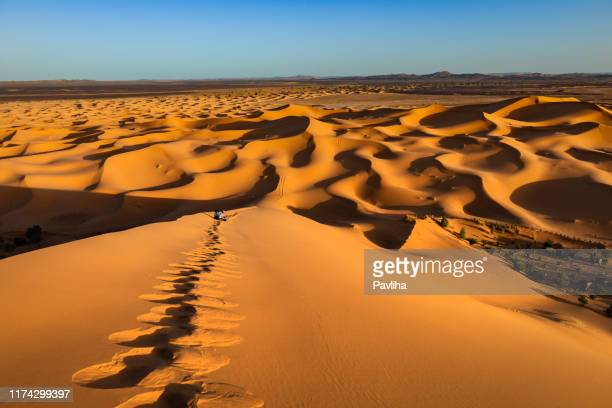 male tourist photographing, sand dunes, afternoon, erg chebbi, morocco, north africa - merzouga stock pictures, royalty-free photos & images