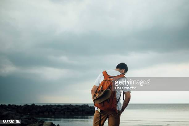 male tourist with backpack is hiking