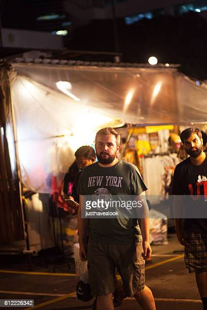 Male tourists with beard on night bazaar