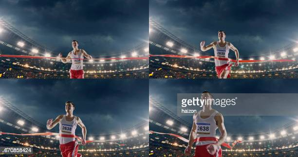 Male track and field runner crosses finishing line