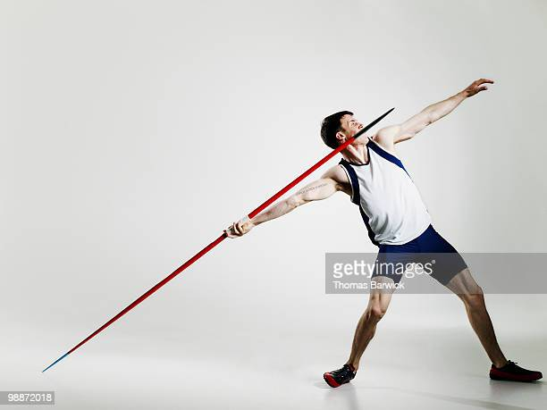 male track athlete preparing to throw javelin - やり投げ ストックフォトと画像