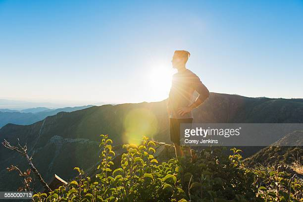 Male trail runner looking out to landscape on Pacific Crest Trail, Pine Valley, California, USA