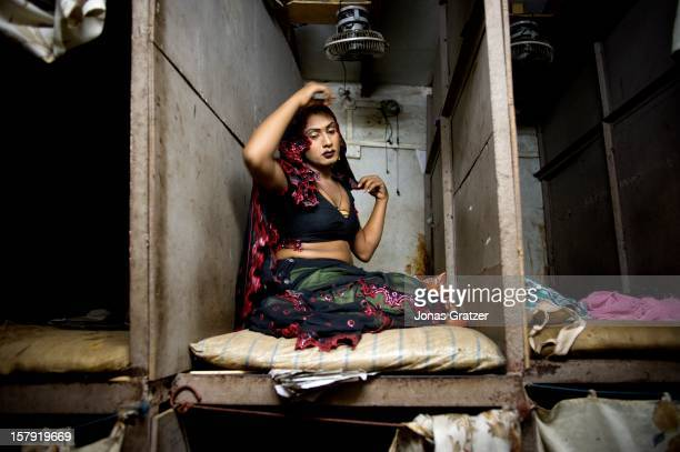 A male transsexual prostitute selling sex inside a brothel in Mumbai's infamous red light district Kamathipura These sex workers service between 20...