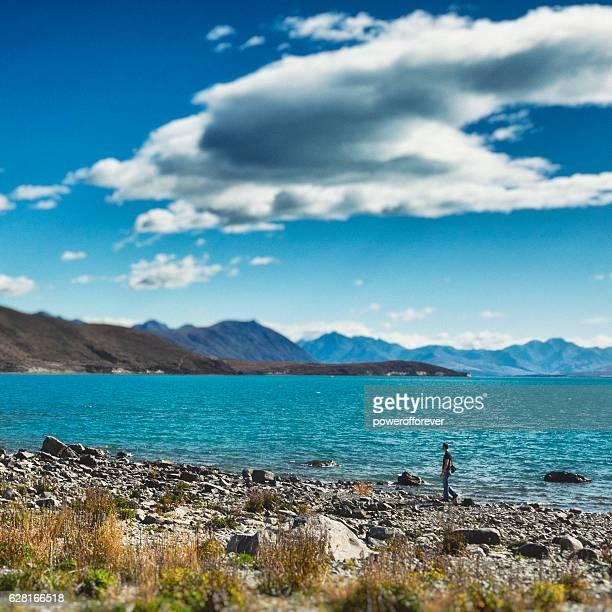 Male traveler at Lake Tekapo, New Zealand
