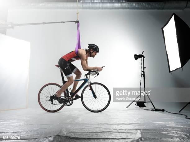 Male triathlete during road race in a studio