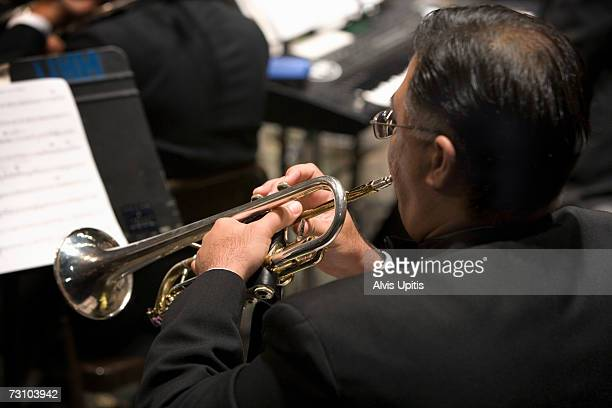 Male trumpet player performing in symphony orchestra