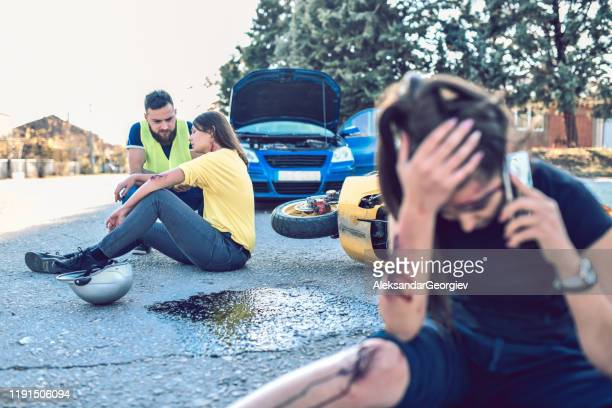 male trying to help females in traffic accident while they call ambulance - gory car accident photos stock pictures, royalty-free photos & images