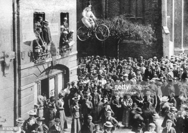 Male undergraduates at Cambridge University protest against the full admission of female students by hanging an effigy of a 'New Woman' on a bicycle...