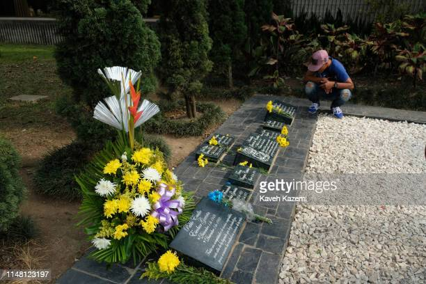 "Male Venezuelan refugee is seen during a pilgrimage to Pablo Escobar""u2019s tomb and his family resting place in Montesacro cemetery on February 13,..."