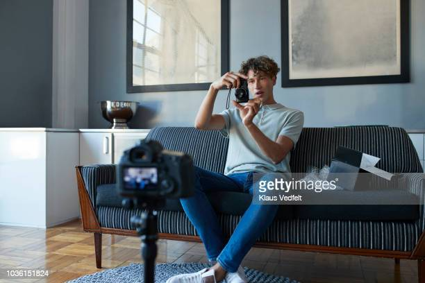 """male vlogger doing """"unboxing"""" video from home - unboxing stock pictures, royalty-free photos & images"""
