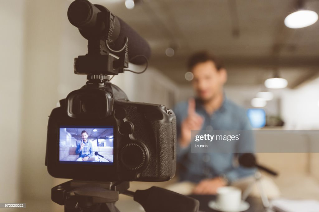 Male vlogger recording content for his vlog : Stock Photo