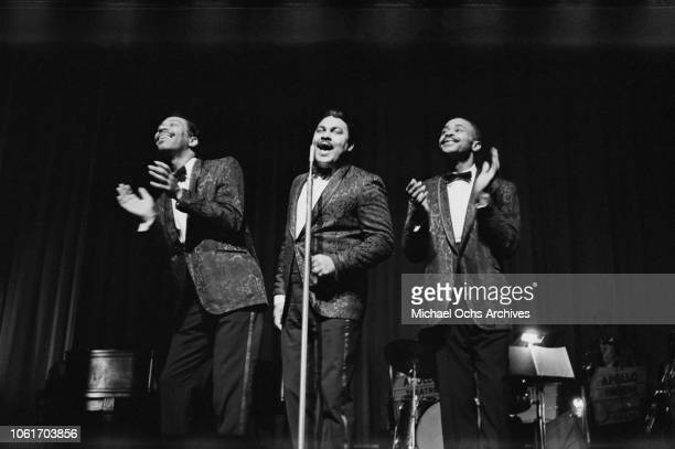 Male vocal group perform at the Apollo Theater in New York City, circa 1965.