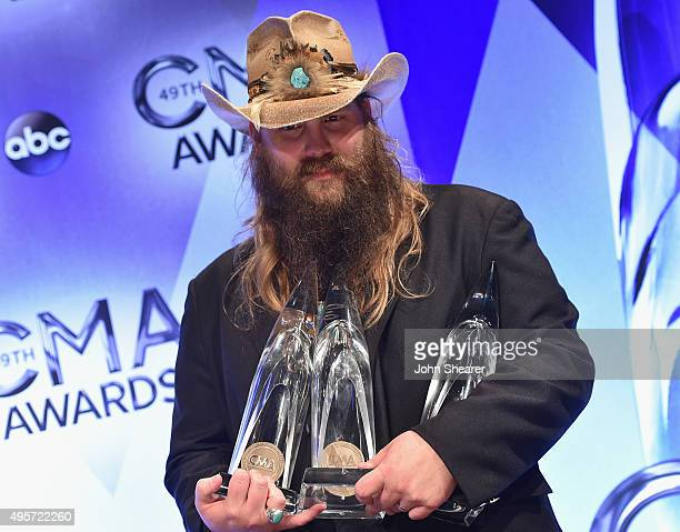 Male Vocalist of the Year winner Chris Stapleton poses in the press room during the 49th annual CMA Awards at the Bridgestone Arena on November 4,...