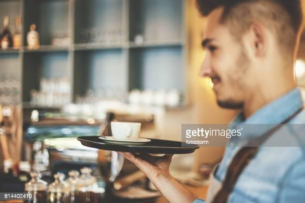 Male waiter holding coffee