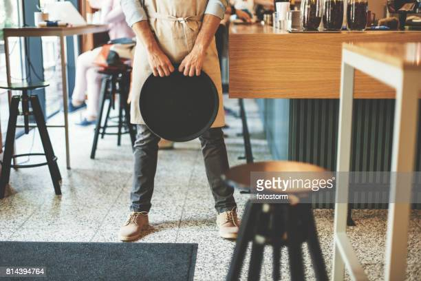 Male waiter holding serving tray