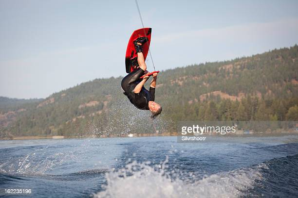 Male wakeboarder in the air doing a flip