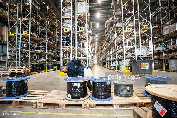 Male warehouse worker checking pallet order