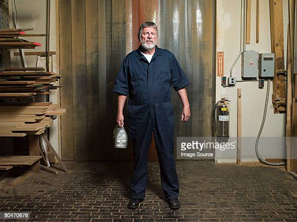 male warehouse worker - coveralls stock pictures, royalty-free photos & images
