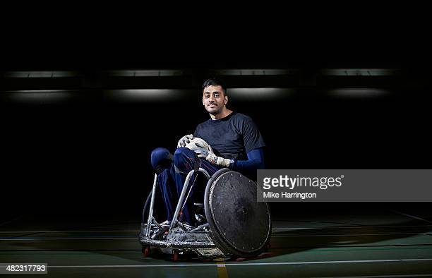 male wheelchair rugby player ready for action. - rugby stock pictures, royalty-free photos & images