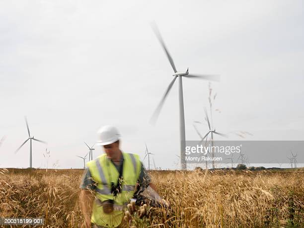 male wind power plant worker at wind farm (blurred motion) - power occupation stock pictures, royalty-free photos & images