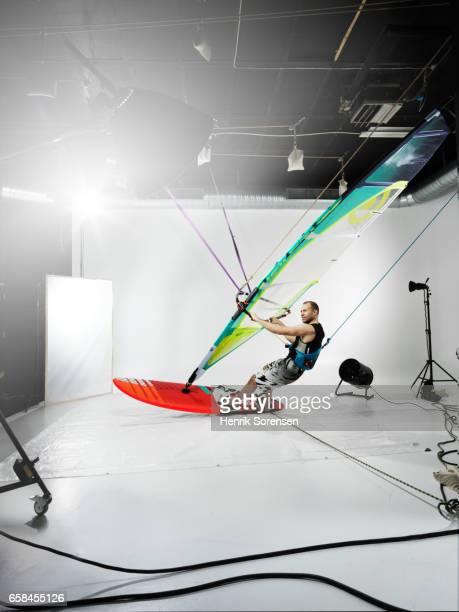 Male windsurfer in a studio