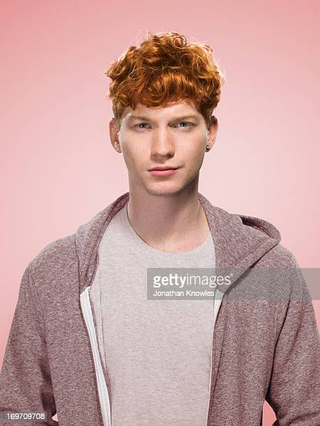 Male with curly red hair in a hoody