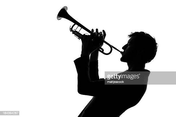 male with trumpet silhouette - trumpet stock photos and pictures