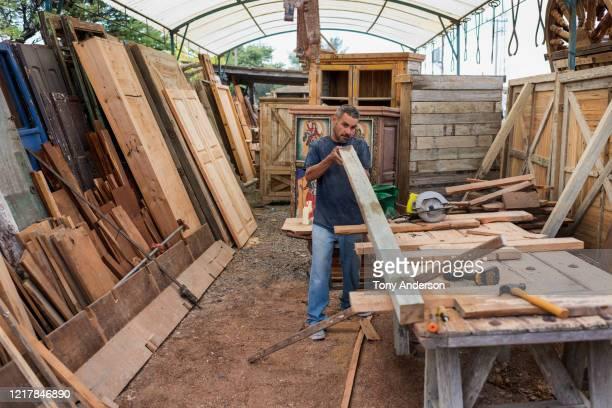 Male worker at artisanal furniture workshop