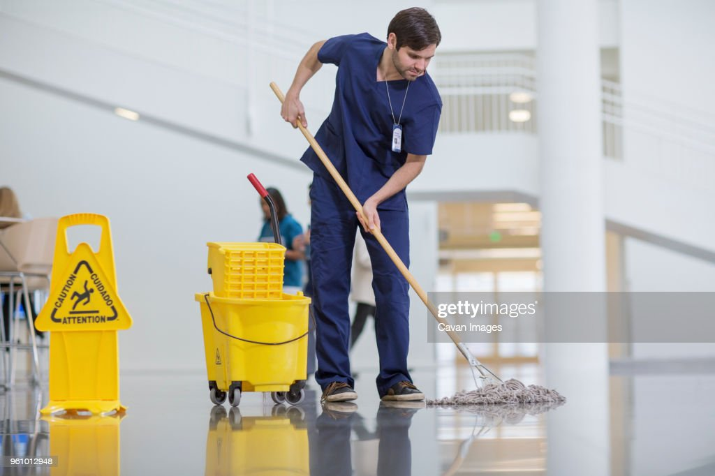 Male worker cleaning hospital floor : Stock Photo