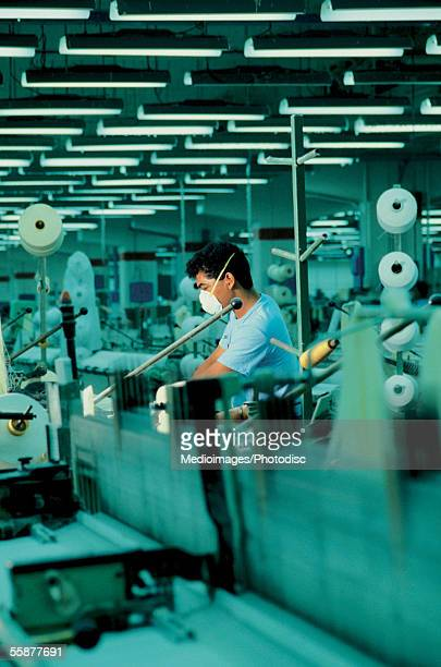 male worker in textile factory - textile factory stock photos and pictures