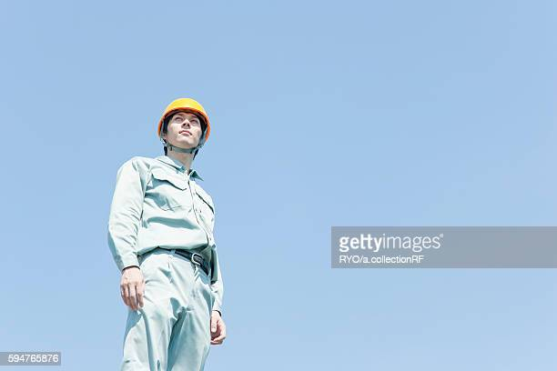 Male Worker in Uniform and Hardhat