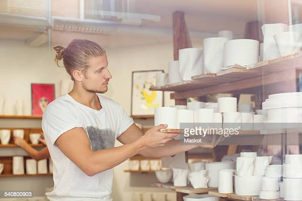 Male worker working in crockery workshop