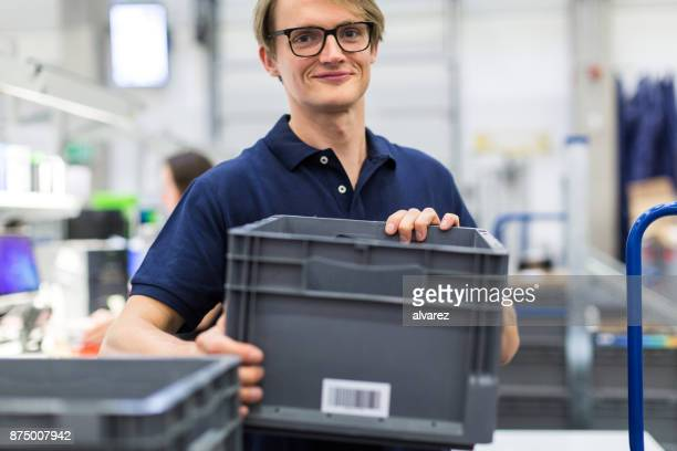 Male worker working in distribution warehouse