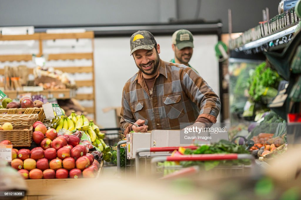 Male workers working at supermarket : Stock Photo