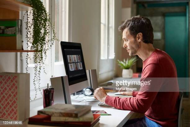 male working from home during coronavirus - working from home stock pictures, royalty-free photos & images