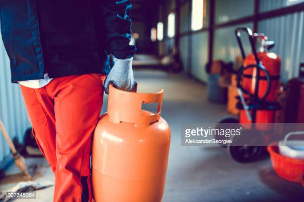 male working taking gas cylinder for checkup - butane stock pictures, royalty-free photos & images