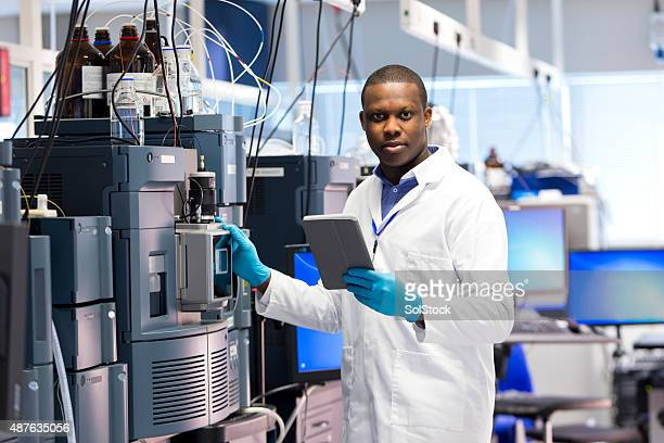 Male Working with Specialist Scientific Equipment for Measuring Chemicals.