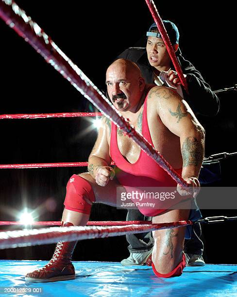 male wrestler and assistant in corner of ring - mixed wrestling stock pictures, royalty-free photos & images