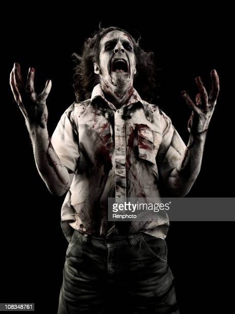 male zombie - zombie makeup stock photos and pictures