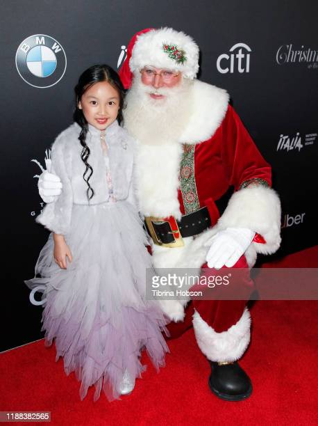 Malea Emma and Santa Claus attend Christmas at The Grove A Festive Tree Lighting celebration at The Grove on November 17 2019 in Los Angeles...