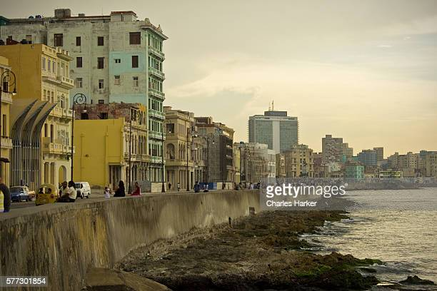 malecon avenue coastal road in havana cuba with vintage apartments and urban skyline - prado stock photos and pictures
