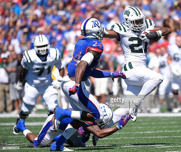 Maleek Irons of the Ohio Bobcats rushes for a first down against Fish Smithson and Bazie Bates IV of the Kansas Jayhawks in the second quarter at...