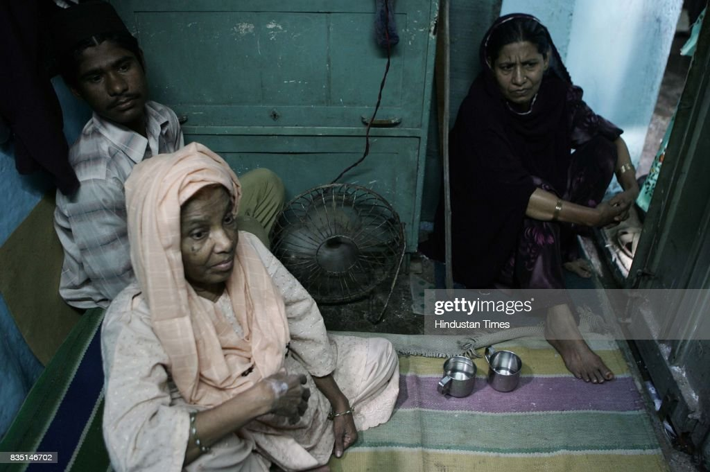 Ruqqaiyya Bano (Left) , mother of Maulana Zahid, an accused in the Malegaon bomb blast, along with Zahid, aunt Azeema Ansari and younger brother Zubair at their hutment in Malegaon. Zahid is accused of planting the bomb at Mushawarat Chowk which took the lives of six people.