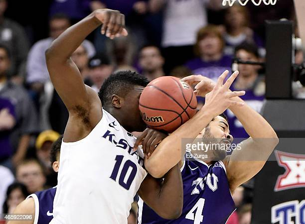 Malek Harris of the Kansas State Wildcats and Amric Fields of the TCU Horned Frogs battle for a rebound during the first round of the Big 12...
