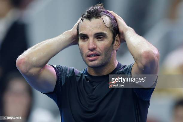Malek Jaziri of Tunisia celebrates after winning against Alexander Zverev of Germany during their Men's Singles 3rd Round match of the 2018 China...