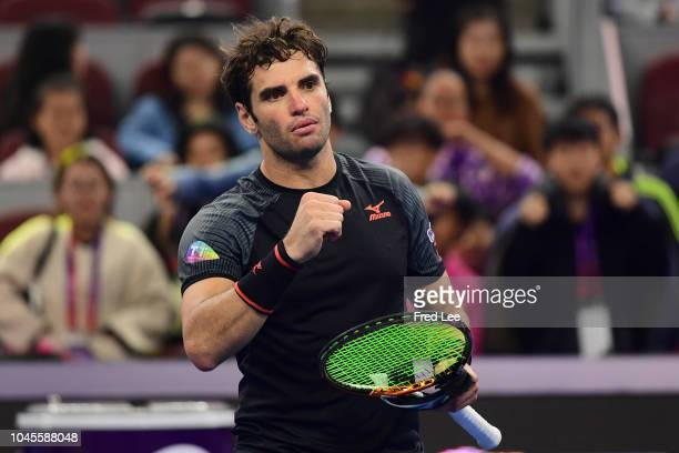 Malek Jaziri of Tunisia celebrates after winning against Alexander Zverev of Germany during their Men's Singles 2nd Round match of the 2018 China...