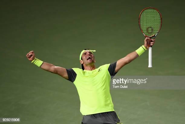Malek Jaziri of Tunisia celebrates his win against Grigor Dimitrov of Bulgaria on day two of the ATP Dubai Duty Free Tennis Championships at the...