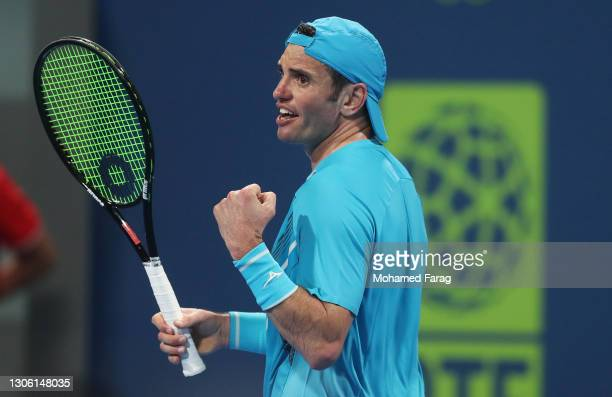 Malek Jaziri of Tunisia celebrates in his Round One match against Norbert Gombos of Slovakia during Day Two of the Qatar ExxonMobil Open 2021 at...