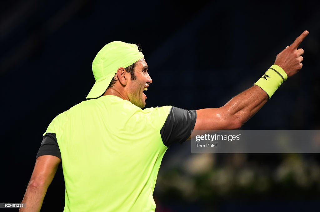 Malek Jaziri of Tunisia celebrates winning the first set during his match against Robin Haase of Netherlands on day three of the ATP Dubai Duty Free Tennis Championships at the Dubai Duty Free Stadium on February 28, 2018 in Dubai, United Arab Emirates.